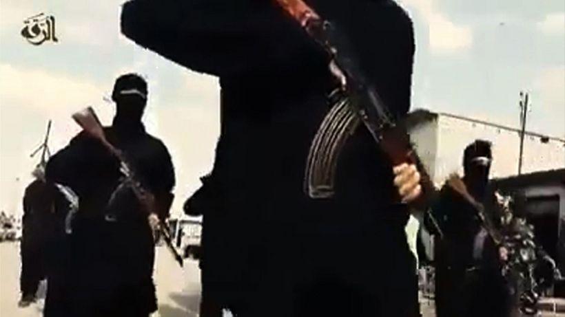 Vígamenn Ríkis íslams í Raqqa. Undir ógnarstjórn samtakanna í borginni ...