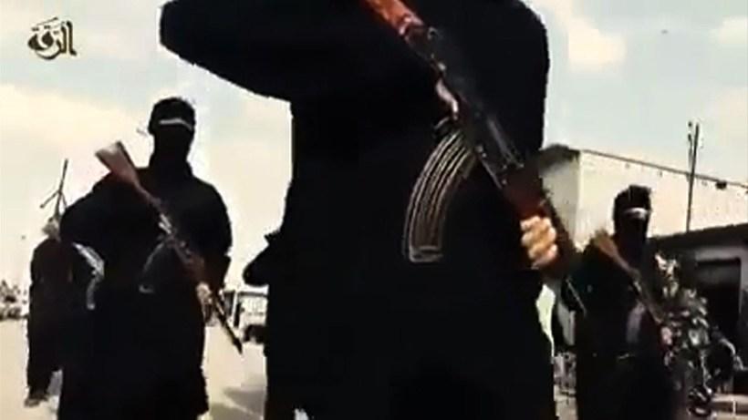 Mynd af vígamönnum Ríkis íslams í Raqqa, er borgin var ...