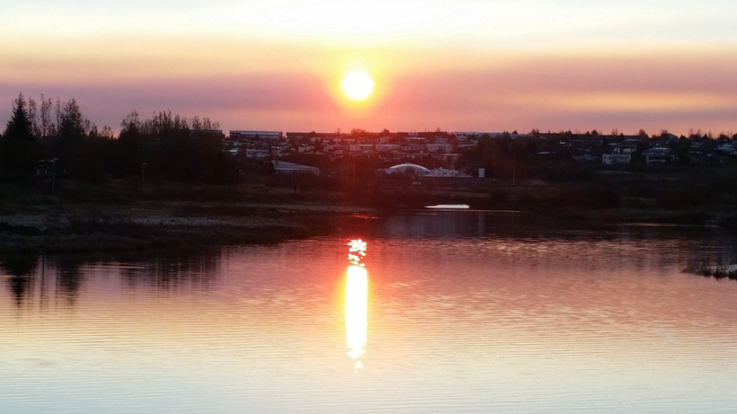 The morning sun gently rising over the Reykjavík suburbs.