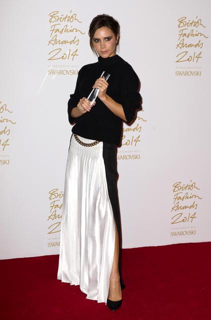 Victoria Beckham í síðu pilsi úr eigin smiðju árið 2014.