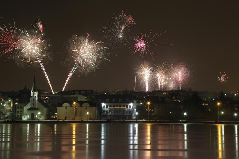 Fireworks seen from Lake Tjörnin in Reykjavik last New Year's ...