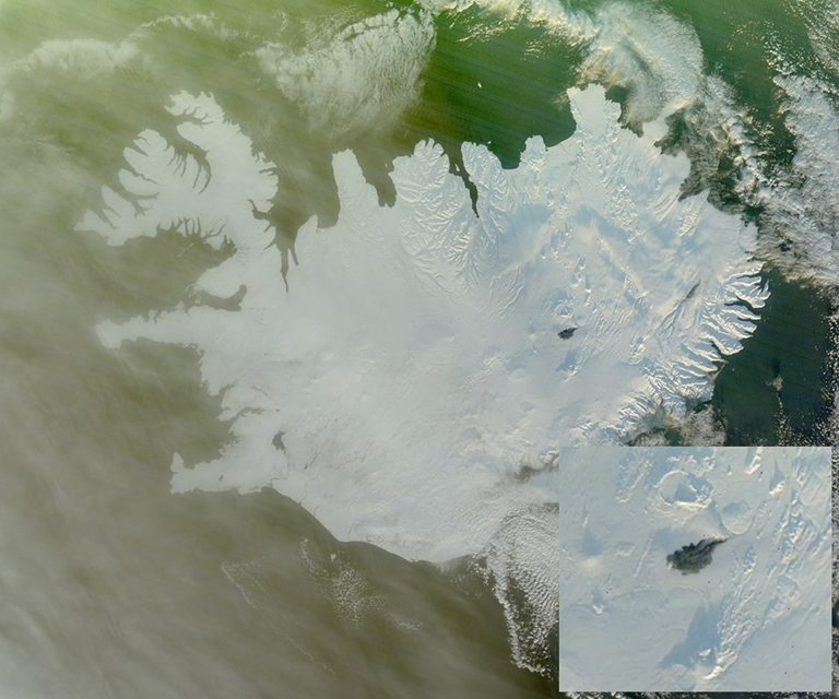 The black lava field is clearly visible on the snowy …