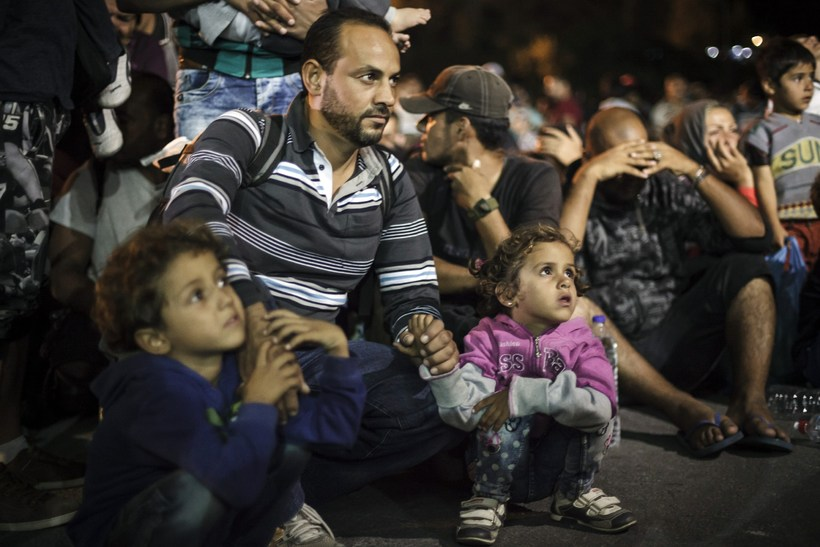 Syrian refugees waiting to board a ferry to Greece.