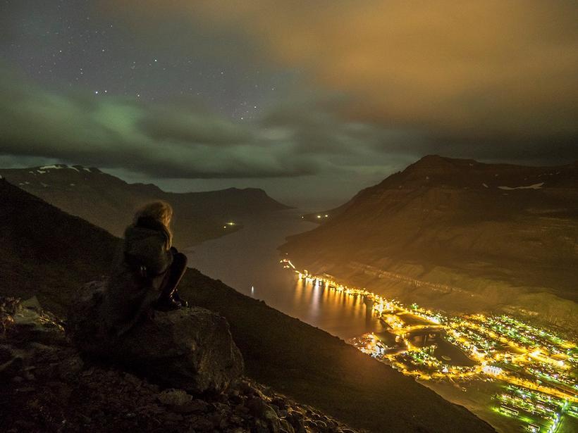 The lights from the town of Seyðisfjörður, which nestles amidst …