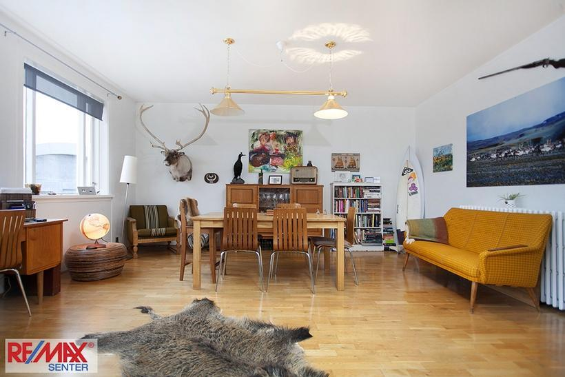 The spacious living room featuring vintage furniture and a couple ...