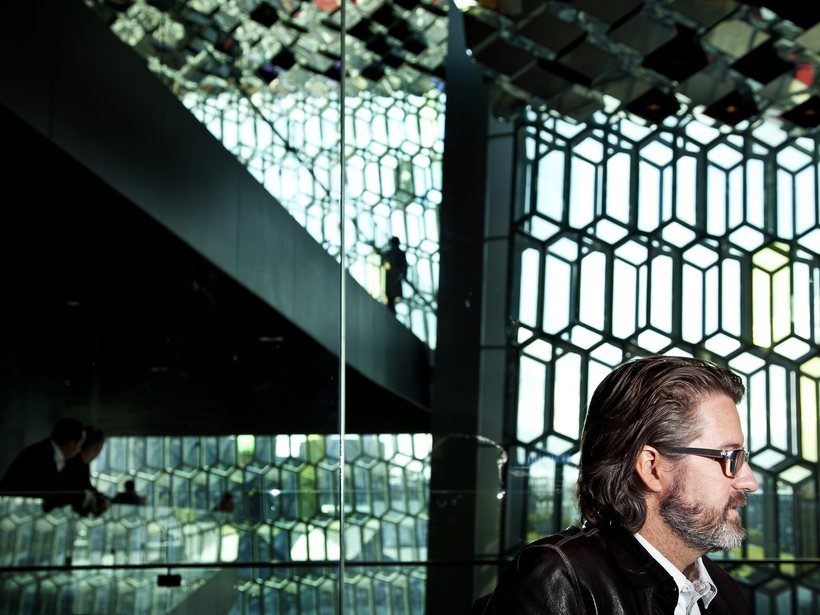 Icelandic artist Ólafur Elíasson in front of the glass facade ...