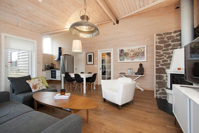 The cabin is bright and airy and features a chimney ...
