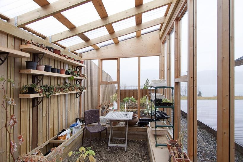 The cottage features a greenhouse for growing your own organic ...