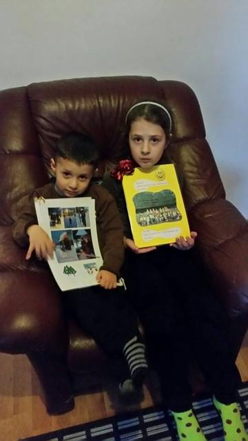 Kevi, aged three, and his sister Klea clutching their memento …