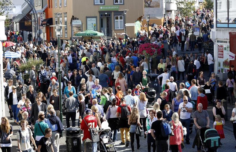 Crowds on Laugavegur in downtown Reykjavik.
