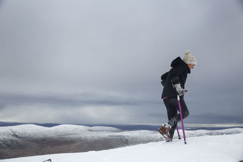 Nikki Bradleyon crutches climbing Mount Errigal