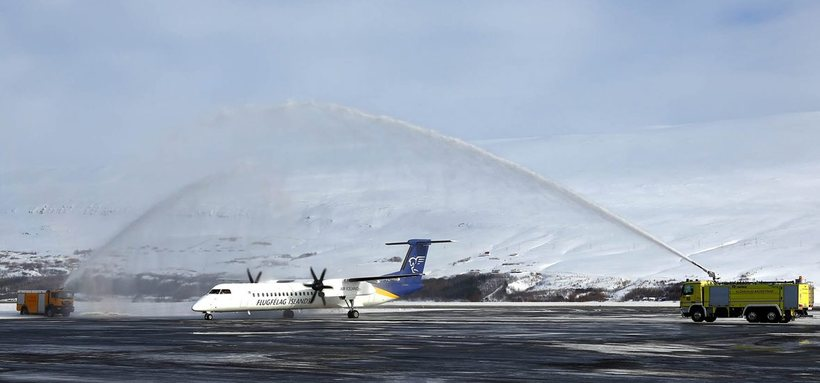 The Akureyri airport fire services welcome the new arrival with ...