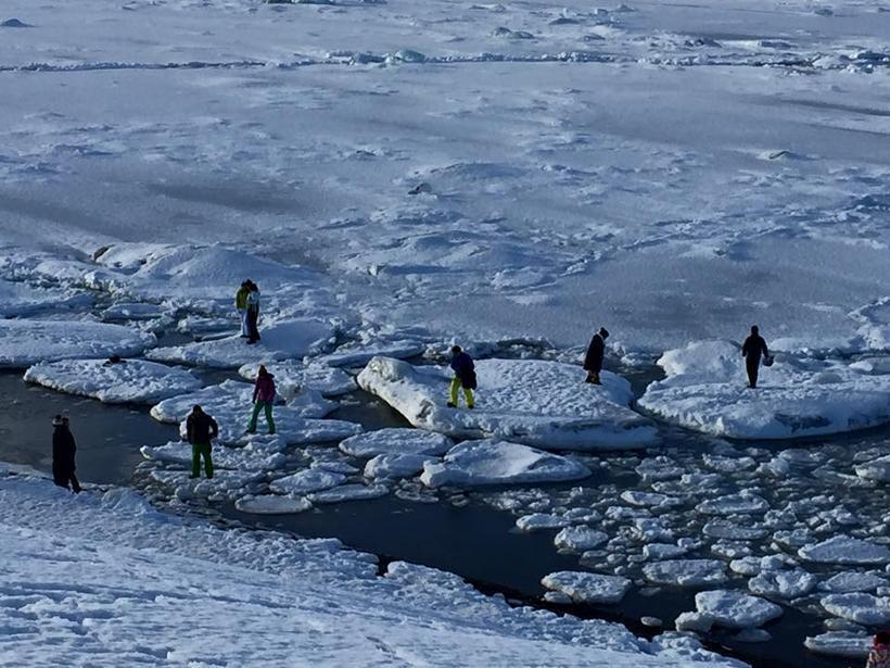 Irresponsible tourists iceberg-hopping in Iceland.