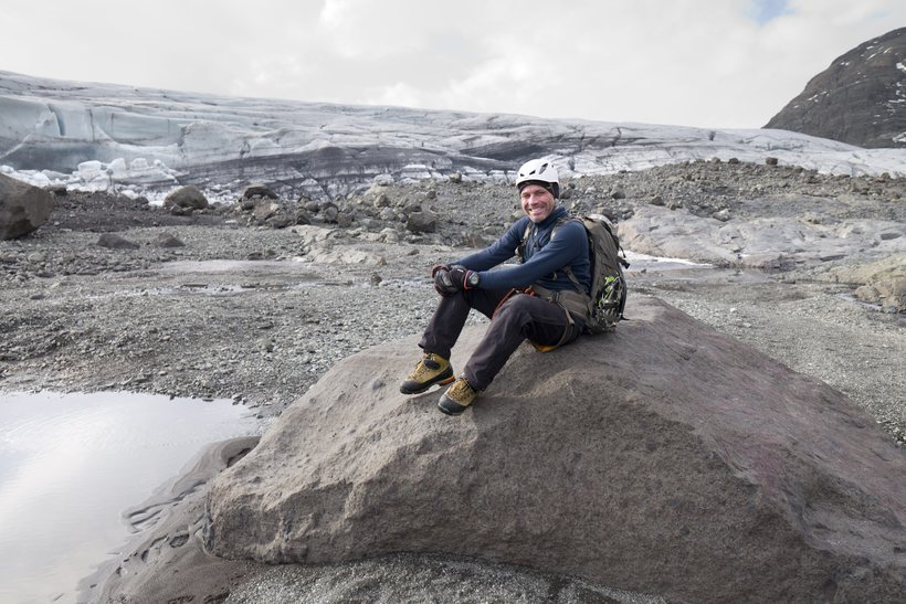 Einar R. Sigurðsson sits on the rock which is now …