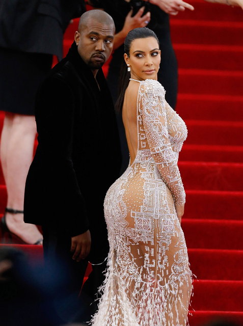 Rap superstar Kanye West and his reality TV star wife ...