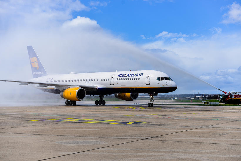 The arriving Icelandair jet gets a water-cannon salute as it …