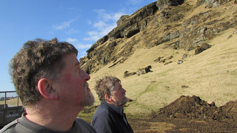 The brothers, Guðjón and Benjamin looking up into the mountain.