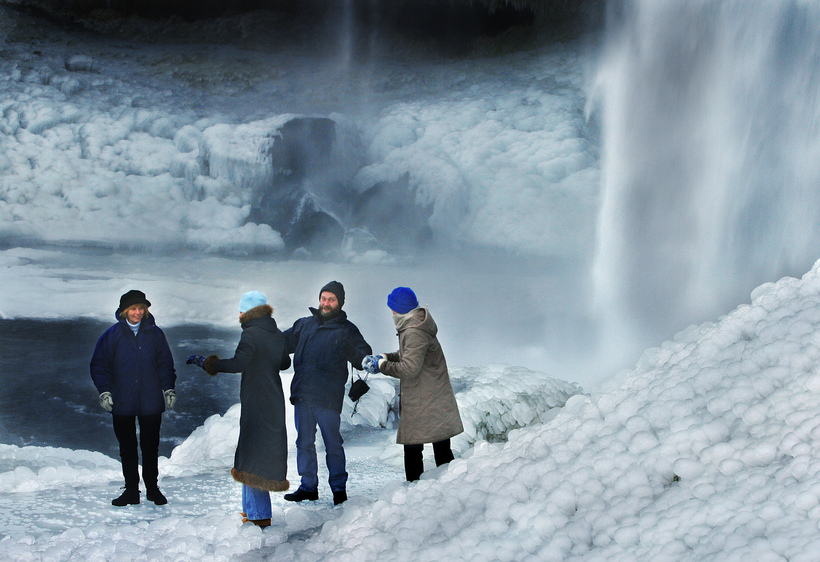 Tourists braving the cold at Seljalandsfoss, South Iceland.