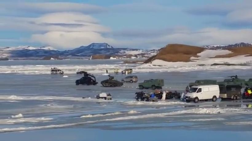 Tanks and army vehicles zooming around on the frozen lake.