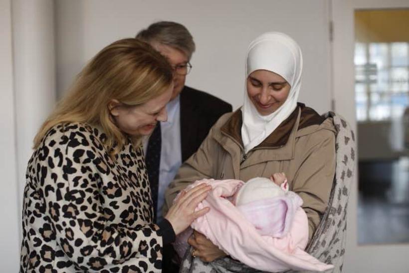 Eygló Harðardóttir welcomes a Syrian mother and baby.