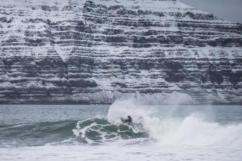 Heiðar Logi surfing in the West Fjords of Iceland in ...