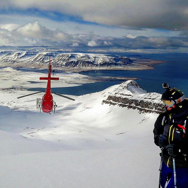 Helicopter returning to base after dropping off skiers at the …