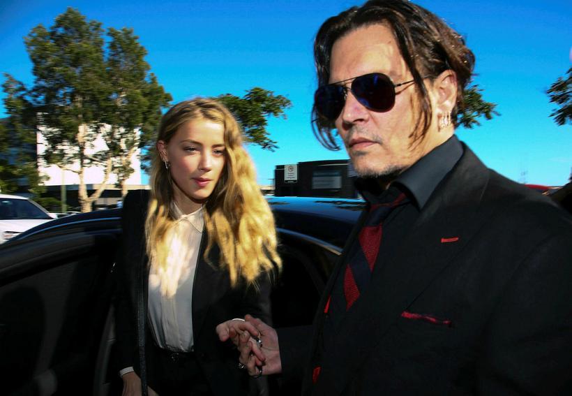 Johnny Depp og Amber Heard á meðan allt lék í …