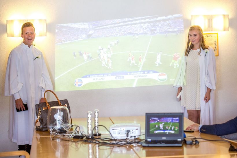 The 13-year-old confirmation children at their reception, watching the match.