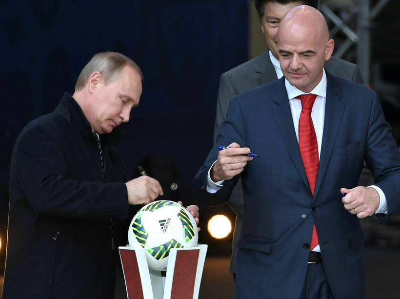 Russian President Vladimir Putin and FIFA President Gianni Infantino signing ...