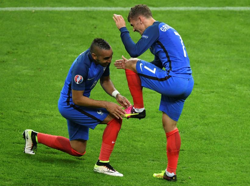 Dimitri Payet and Antoine Griezmann celebrating one of France's five …