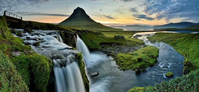 Beautiful Kirkjufell with the Kirkjufellsfoss waterfall in the foreground.