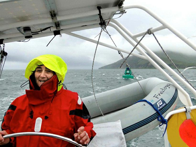 Frédo steering the boat in rather bad weather in Iceland.
