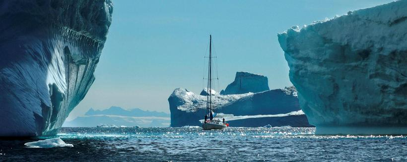 The Fredoya sailing between icebergs in Greenland.