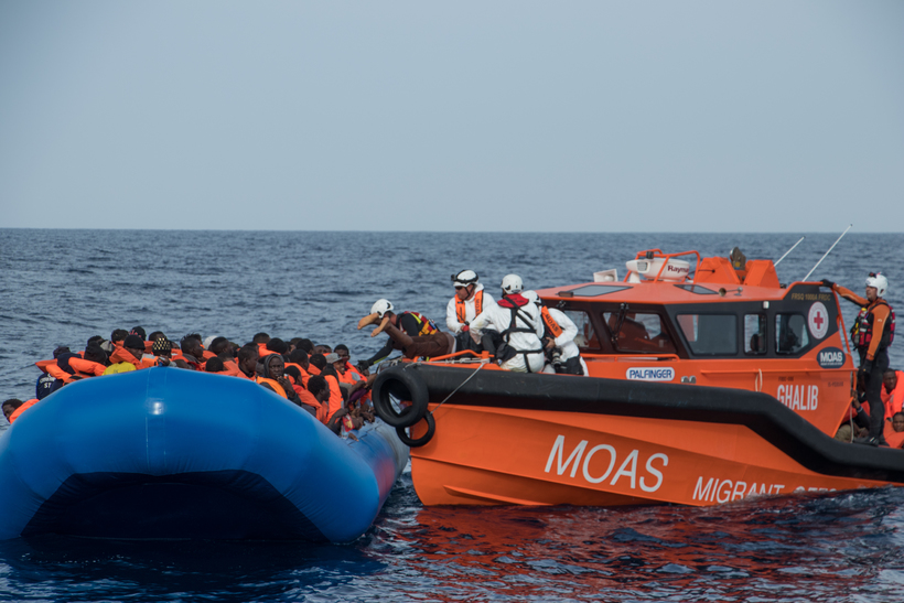 Everyone aboard gets a lifevest before they are ferried into ...