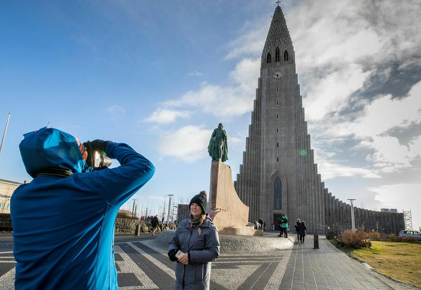 Tourists at Hallgrímskirkja church in central Reykjavik.