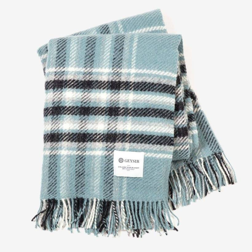 A lush woolen blanket from country chic store Geysir. We ...