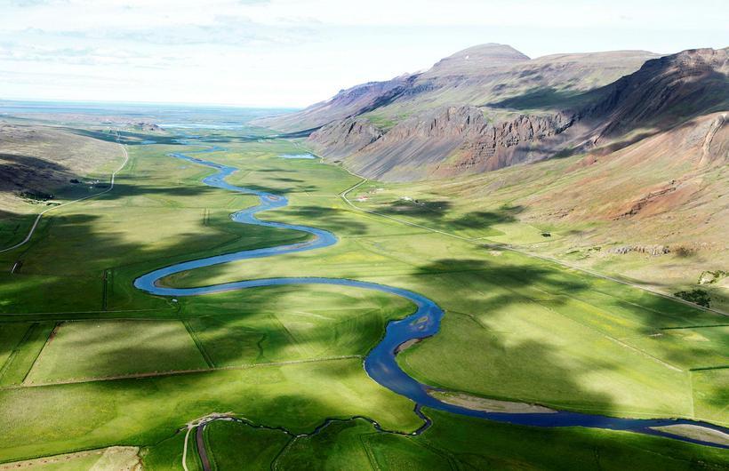 Vatnsdalsá runs through the green valley Vatnsdalur which it draws …
