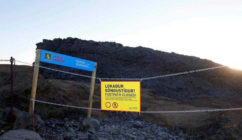"""""""Footpath closed"""" - yet tourist keep climbing over the barriers."""