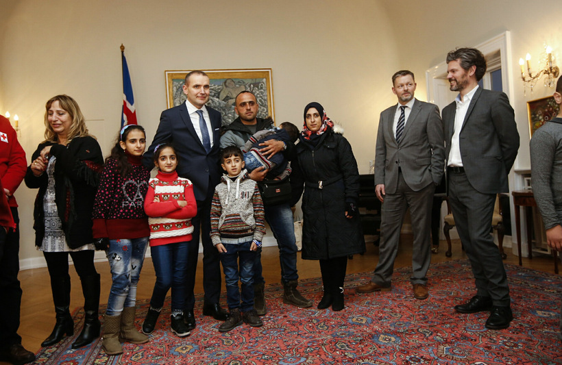 The Syrian refugees pose with the President. On the far ...