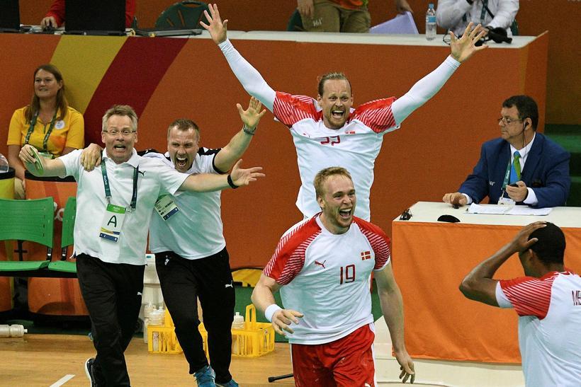 Guðmundur Guðmundsson (left) and the Danish players celebrating their victory.