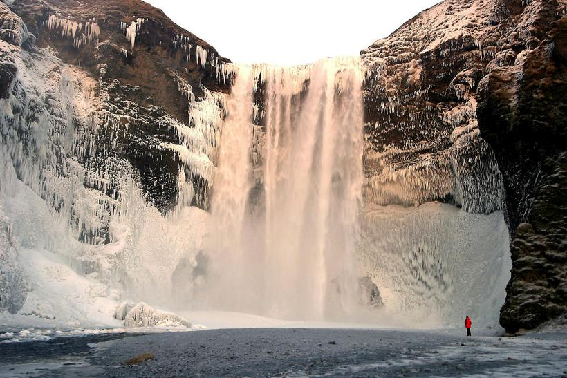Skógarfoss is stunning in icy surroundings