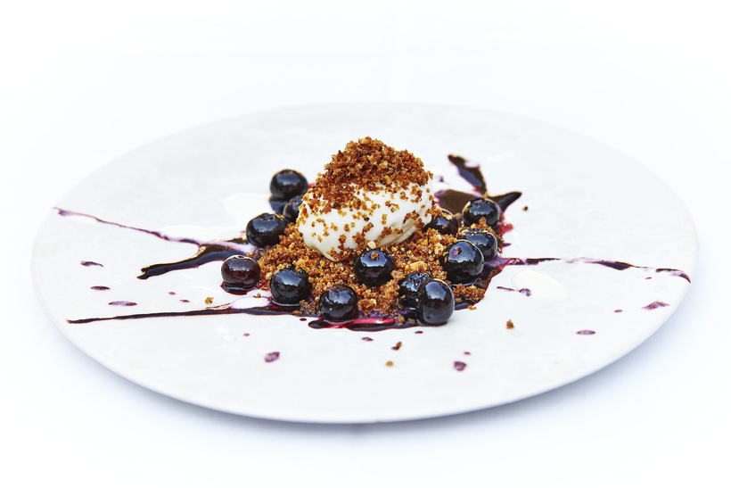 Bluberries with honey parfait and rye bread crumble.