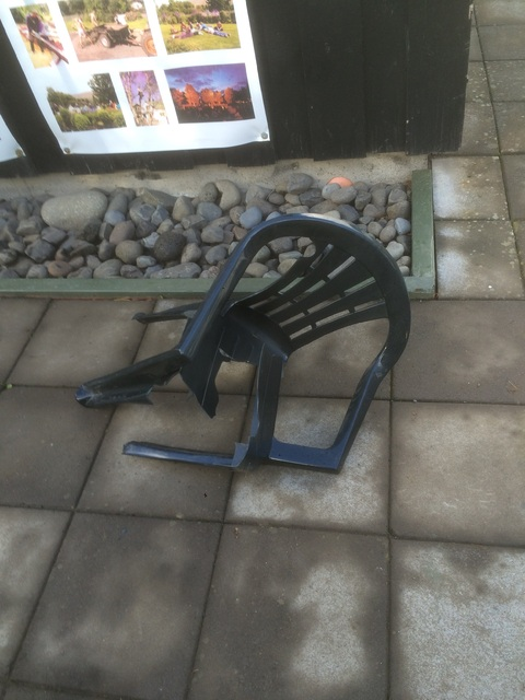 A broken plastic chair.
