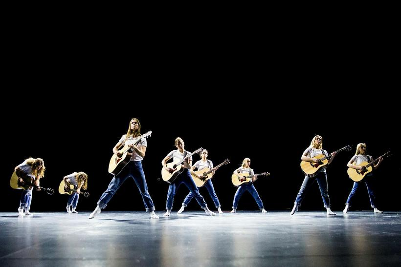 Dancers playing guitar in a work called No Tomorrow by …