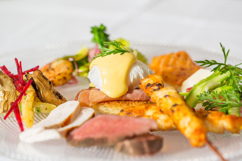 Eggs Benedict, roast beef and chicken skewers are some of ...