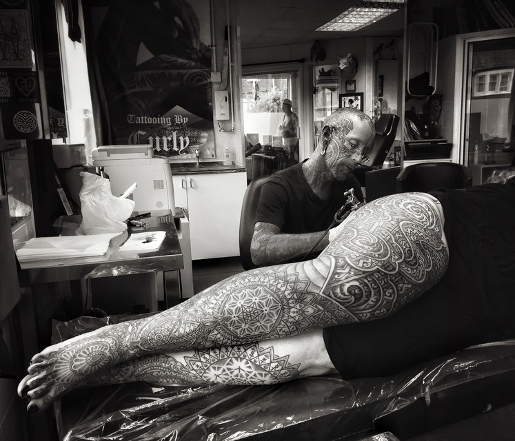 Habba being tattooed by Curly Moore.