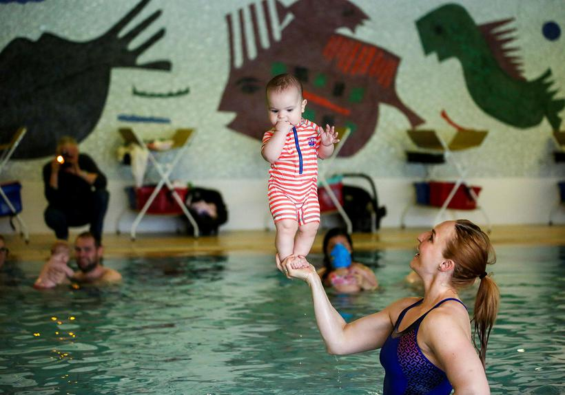 A baby at a swimming class in Iceland. This class …
