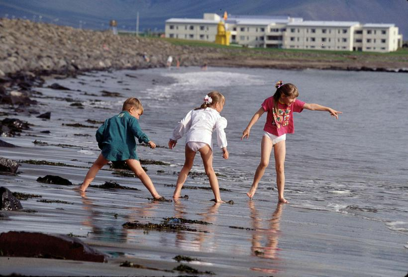 Kids like getting their feet wet in Langisandur on a ...