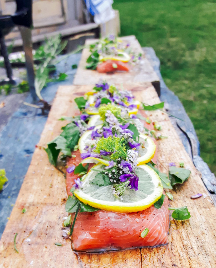 Fresh salmon ready to be barbecued on an open fire.