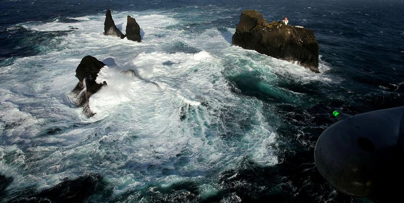 The strong surf below the lighthouse.